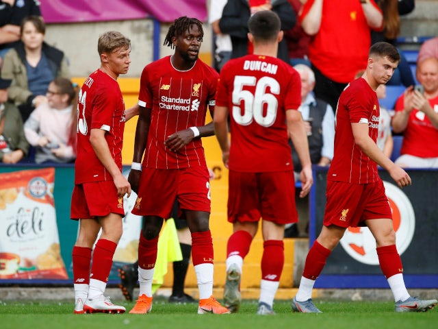 Divock Origi is congratulated after scoring Liverpool's fifth goal in the pre-season friendly with Tranmere Rovers on July 11, 2019