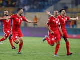 Tunisia players celebrate after winning the match against Ghana on July 8, 2019