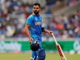India's Virat Kohli reacts after losing his wicket on July 10, 2019