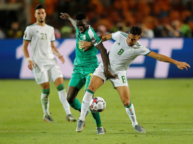 Algeria's Youcef Belaili in action with Senegal's Ismaila Sarr in the Africa Cup of Nations final on July 19, 2019