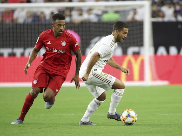 Real Madrid's Eden Hazard in action with Bayern Munich's Corentin Tolisso in the International Champions Cup on July 20, 2019