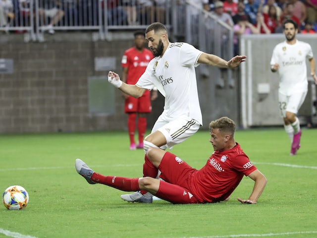 Real Madrid's Karim Benzema in action with Bayern Munich's Joshua Kimmich in the International Champions Cup on July 20, 2019