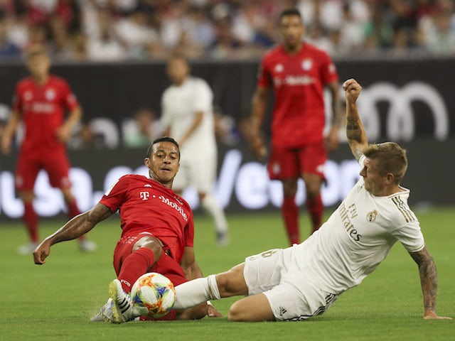 Real Madrid's Toni Kroos in action with Bayern Munich's Thiago in the International Champions Cup on July 20, 2019