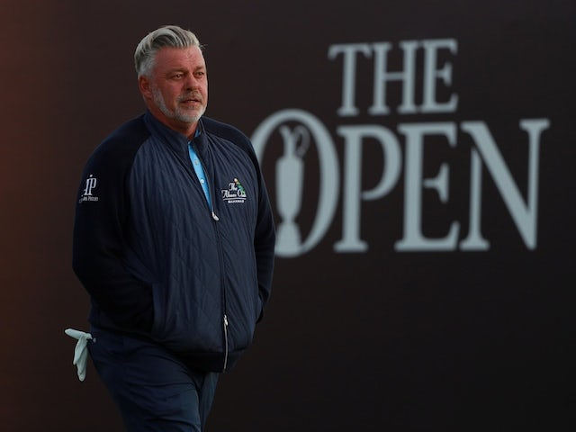 Home favourite Darren Clarke takes surprise lead at Open