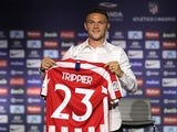 Atletico Madrid's new signing Kieran Trippier poses with a shirt during the unveiling on July 18, 2019