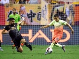 Ruben Neves and Ian Carlo Poveda-Ocampo fight for the ball as Wolverhampton Wanderers face Manchester City in the Premier League Asia Trophy.