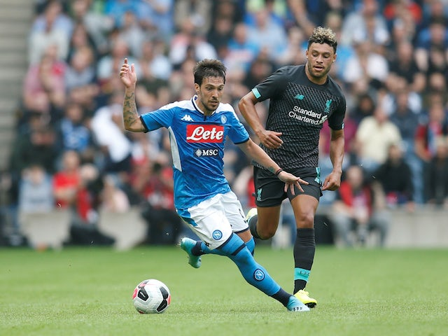 Napoli's Simone Verdi in action with Liverpool's Alex Oxlade-Chamberlain in pre-season on July 28, 2019