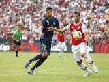 Arsenal's Henrikh Mkhitaryan in action with Real Madrid's Raphael Varane in the International Champions Cup on July 23, 2019