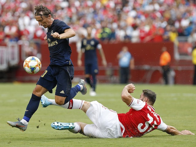 Arsenal's Sead Kolasinac in action with Real Madrid's Luka Modric in the International Champions Cup on July 23, 2019