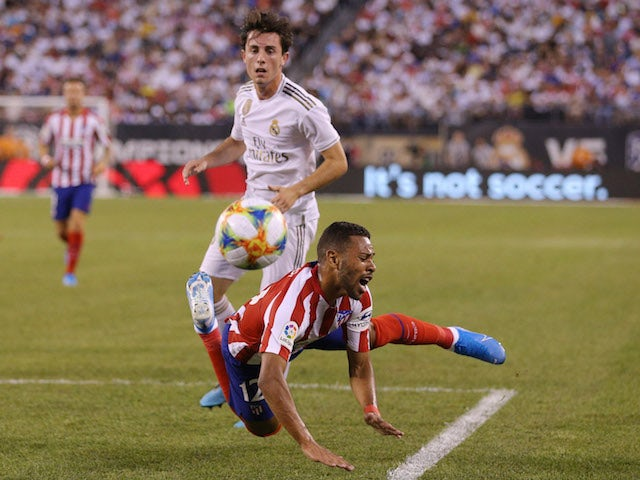 Real Madrid's Alvaro Odriozola in action with Atletico Madrid's Renan Lodi in the International Champions Cup on July 26, 2019