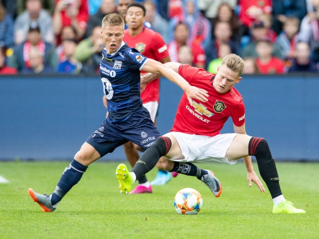 Manchester United's Scott McTominay and Kristiansund's Torgil Gjertsen in action during a friendly in Oslo on July 30, 2019