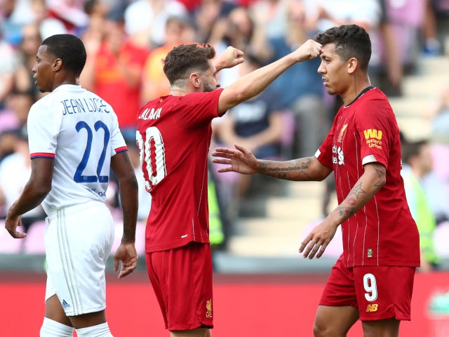 Roberto Firmino celebrates with Adam Lallana after equalising for Liverpool against Lyon on July 31, 2019