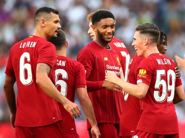 Harry Wilson is congratulated by his Liverpool teammates after scoring against Lyon on July 31, 2019