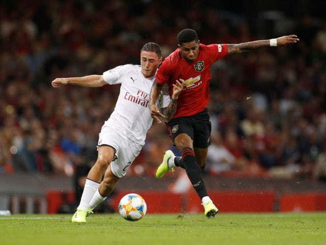 Manchester United's Marcus Rashford in action with AC Milan's Davide Calabria on August 3, 2019