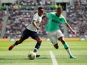 Tottenham Hotspur's Kyle Walker-Peters in action with Inter Milan's Dalbert Henrique in the International Champions Cup on August 4, 2019