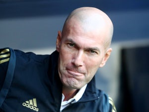 A freshly-shaven Zinedine Zidane watches his Real Madrid side on July 30, 2019