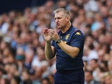 Dean Smith watches on during the Premier League game between Tottenham Hotspur and Aston Villa on August 10, 2019
