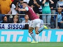 John McGinn celebrates opening the scoring during the Premier League game between Tottenham Hotspur and Aston Villa on August 10, 2019