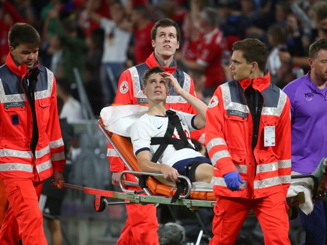 Tottenham Hotspur defender Juan Foyth is stretchered off during the Audi Cup final with Bayern Munich on July 31, 2019.