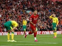 Liverpool forward Roberto Firmino celebrates an own goal from Norwich City defender Grant Hanley in the Premier League on August 9, 2019