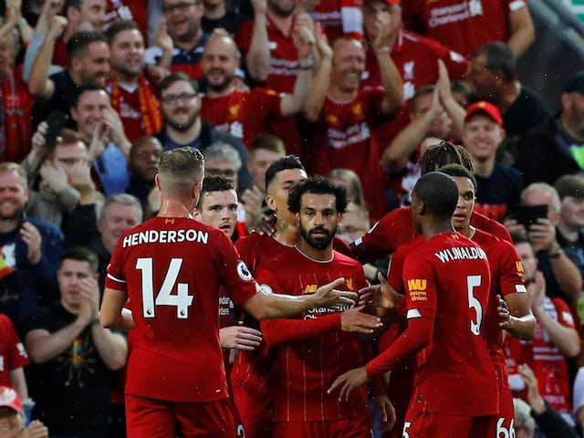 Liverpool players celebrate Mohamed Salah's goal against Norwich City in the Premier League on August 9, 2019