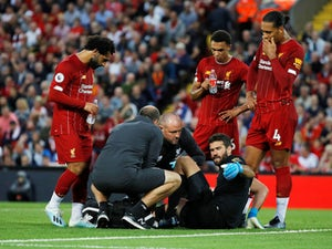 Liverpool goalkeeper Alisson Becker goes down injured against Norwich on August 9, 2019