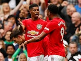 Manchester United's Marcus Rashford celebrates scoring their third goal with Anthony Martial on August 11, 2019