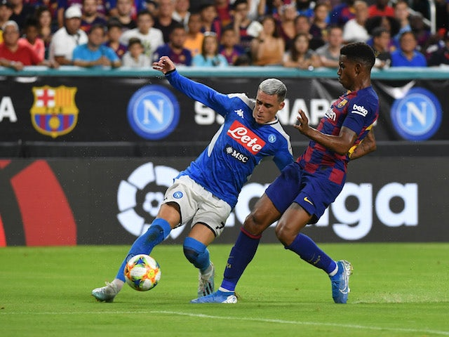 Napoli's Jose Callejon in action with Barcelona's Junior Firpo in a pre-season match on August 7, 2019