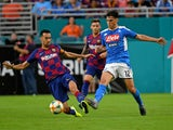 Napoli's Eljif Elmas in action with Barcelona's Sergio Busquets in a pre-season match on August 7, 2019