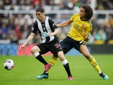 Miguel Almiron and Matteo Guendouzi compete for the ball as Newcastle United play Arsenal on August 11, 2019.