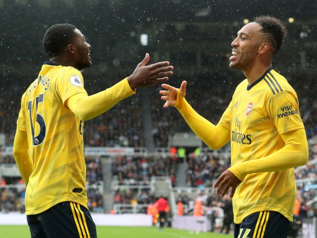 Ainsley Maitland-Niles and Pierre-Emerick Aubameyang celebrate Arsenal's opening goal against Newcastle United on August 11, 2019.