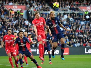 Paris Saint Germain's Maxim Choupo-Moting in action with Nimes's Renaud Ripart in Ligue 1 on February 23, 2019