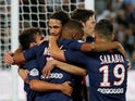 Paris Saint-Germain's Kylian Mbappe celebrates scoring their second goal with Edinson Cavani and team mates on August 11, 2019