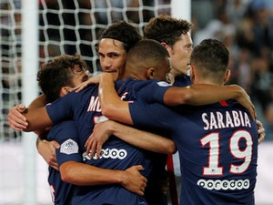 Paris Saint-Germain's Kylian Mbappe celebrates scoring their second goal with Edinson Cavani and team mates on August 11, 2019