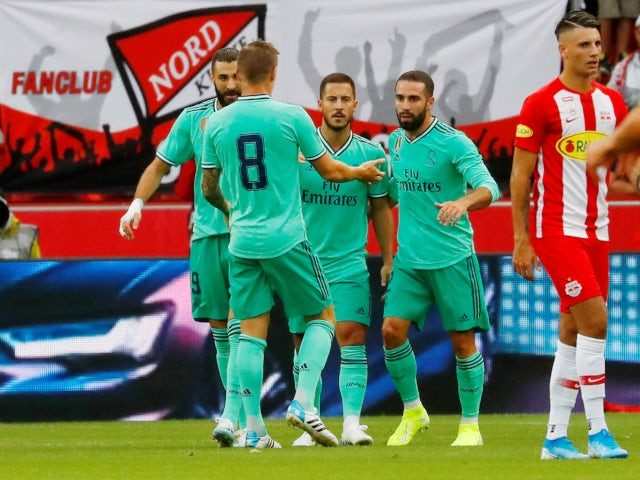 One Hazard celebrates with Real Madrid teammates after opening scoring against Red Bull Salzburg on 7 August 2019