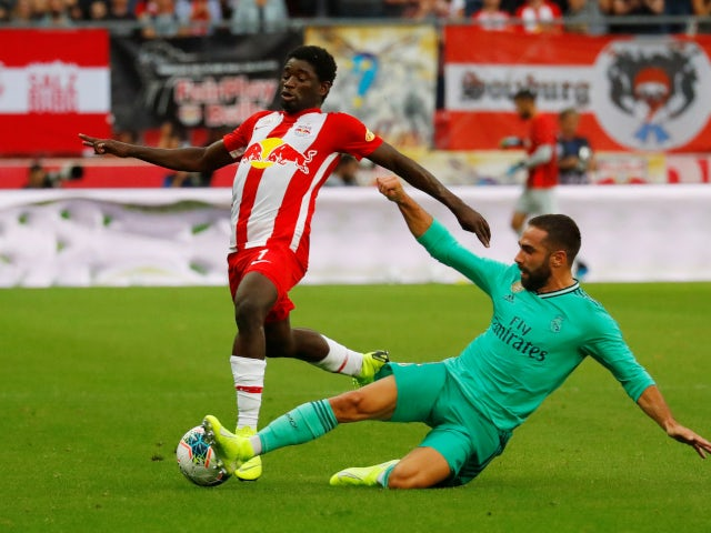 Real Madrid player Dani Carvajal in action with Red Bull Salzburg, Seku Quita, on August 7, 2019