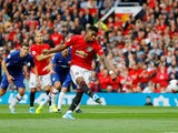 Marcus Rashford scores from the spot during the Premier League game between Manchester United and Chelsea on August 11, 2019