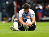 Everton's Andre Gomes sits injured on August 10, 2019