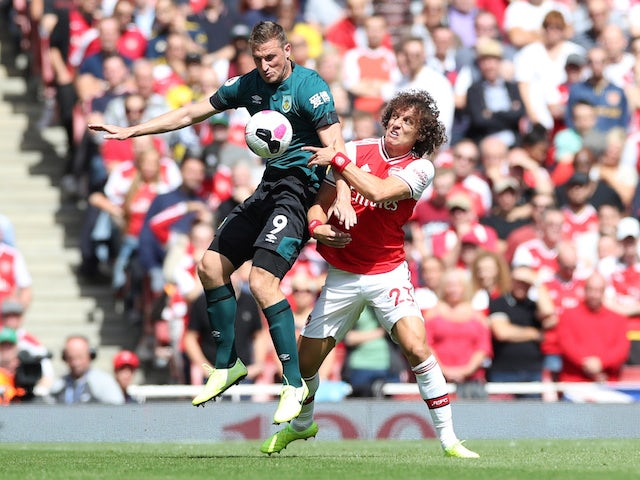 Arsenal's David Luiz battles Burnley's Chris Wood for the ball in the Premier League on August 17, 2019