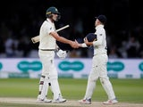 Australia's Pat Cummins and England's Rory Burns shake hands at the end of play as the second test ends in a draw on August 18, 2019