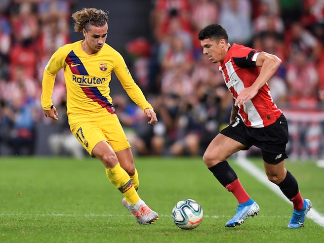 Athletic Bilbao's Ander Capa in action with Barcelona's Antoine Griezmann on August 16, 2019