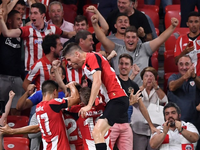 Athletic Bilbao's Aritz Aduriz celebrates scoring their first goal with team mates on August 16, 2019