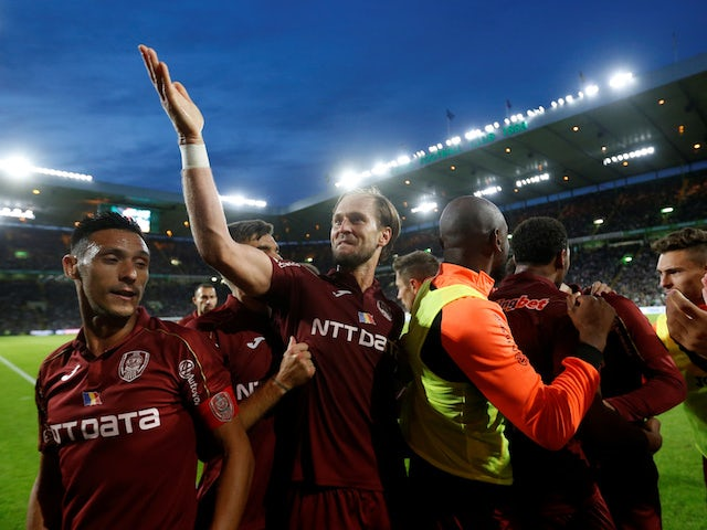 CFR Cluj's Billel Omrani celebrates scoring their second goal with team mates on August 13, 2019