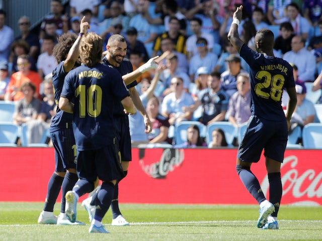 Real Madrid players celebrate Karim Benzema's goal against Celta Vigo in La Liga on August 17, 2019