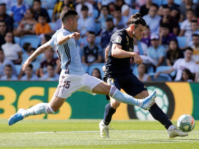 Real Madrid's Gareth Bale in action with Celta Vigo's Lucas Olaza in La Liga on August 17, 2019