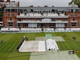 Groundstaff remove the covers before play on the first day of the second Ashes Test on August 14, 2019