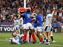 France's Alivereti Raka celebrates with team mates after scoring their first try on August 17, 2019