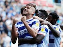 Reading's George Puscas celebrates scoring their second goal against Cardiff on August 18, 2019