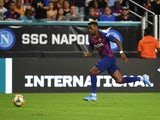 Barcelona defender Jean-Clair Todibo (6) chases the ball during the second half of the United States La Liga-Serie A Cup Tour soccer match against Napoli at Hard Rock Stadium in August 2019