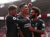Liverpool's Roberto Firmino celebrates scoring their second goal with teammates Alex Oxlade-Chamberlain and Mohamed Salah on August 17, 2019